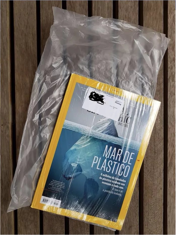 National-Geographic-magazine-that-warns-about-danger-of-plastic-bags-comes-inside-a-plastic-bag-that-is-inside-a-plastic-bag.jpg